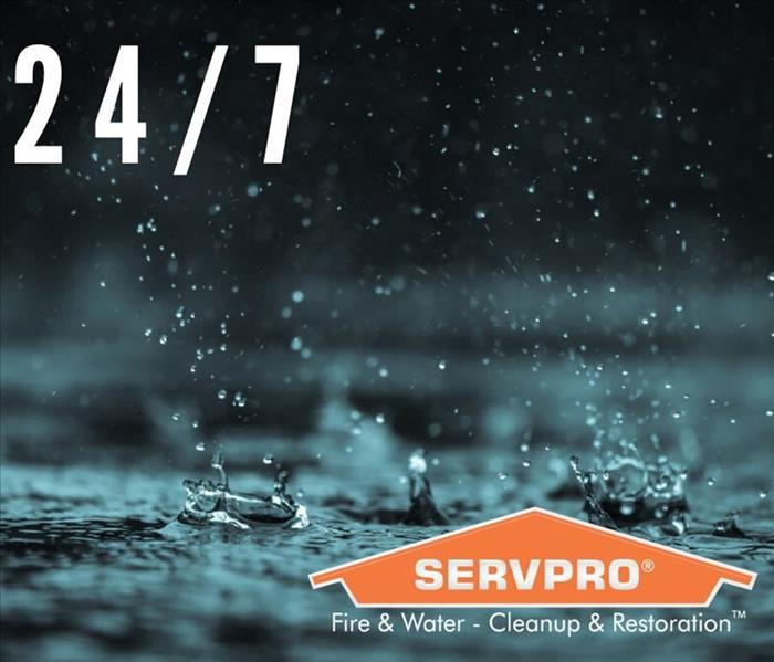 Pouring rain and text that says 24/7 with SERVPRO logo