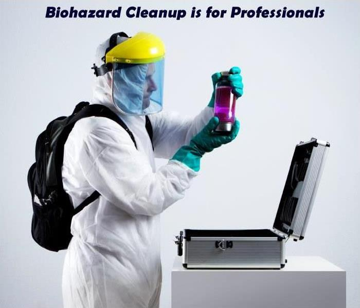 SERVPRO technician in biohazard protective wear with text that says bio hazard is professionals